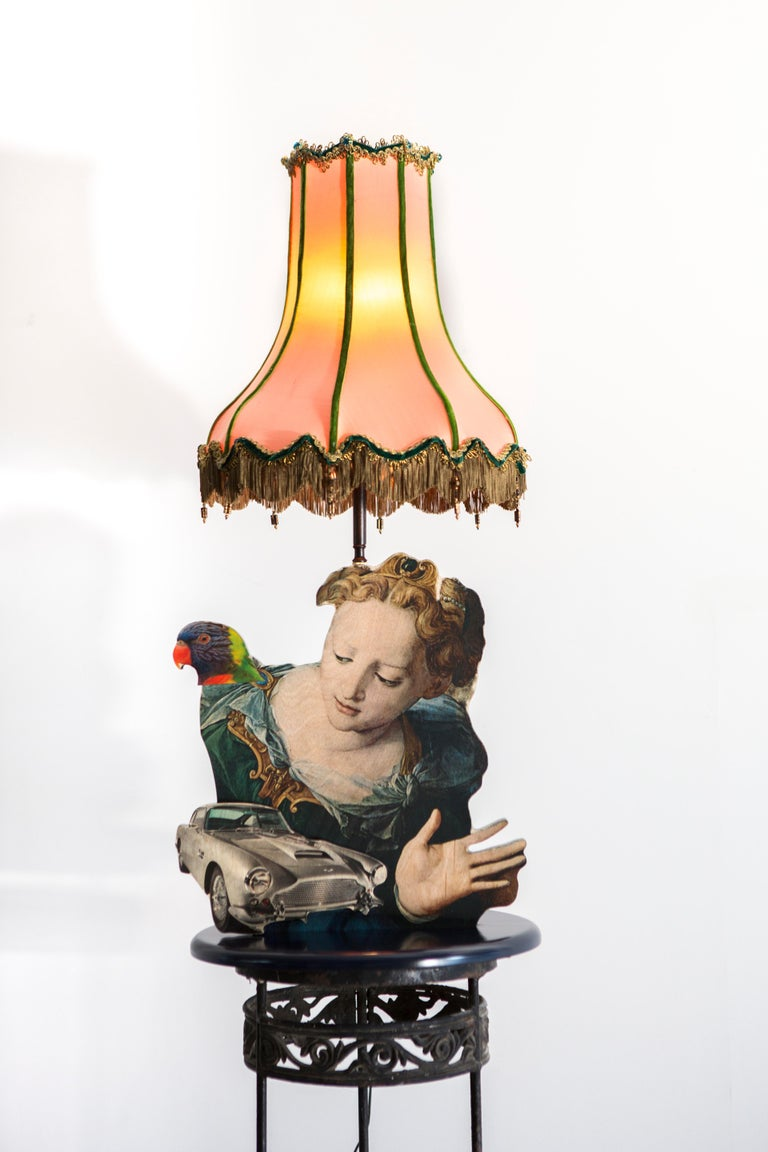This sculptural table lamp from Mattia Biagi's Metropolitan Sets series expresses the personal investigation of the artist straddling life and death, nature and civilization, preservation and transformation. The images used to build the bodies of
