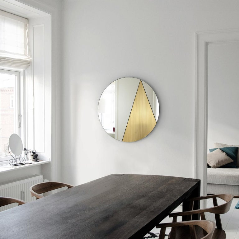 Mirrored surfaces and metals come together to reveal an abstract decoration enclosed in the round Silhouette of this stunning, handmade mirror from the Res Collection. Functional yet intriguing, this piece will make a statement in a contemporary