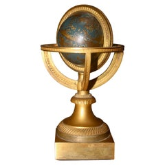 Restauration Gilded and Epargne Armillary Sphere and Paperweight, circa 1830