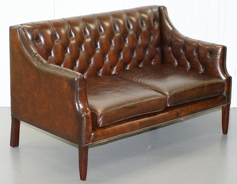We are delighted to this very rare mid century Lutyen's Viceroy style Chesterfield hand dyed cigar brown leather sofa  A very rare model sofa, originally made by Lutyen's in the latter part of the Victorian era, the family still make the chair