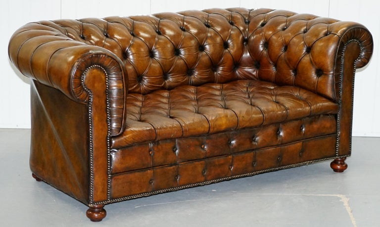 We are delighted to offer for sale this stunning fully restored circa 1900 hand dyed Whiskey brown leather sofa with original horse hair padding and coil sprung front edge   The sofa has been fully restored to include having the old colour