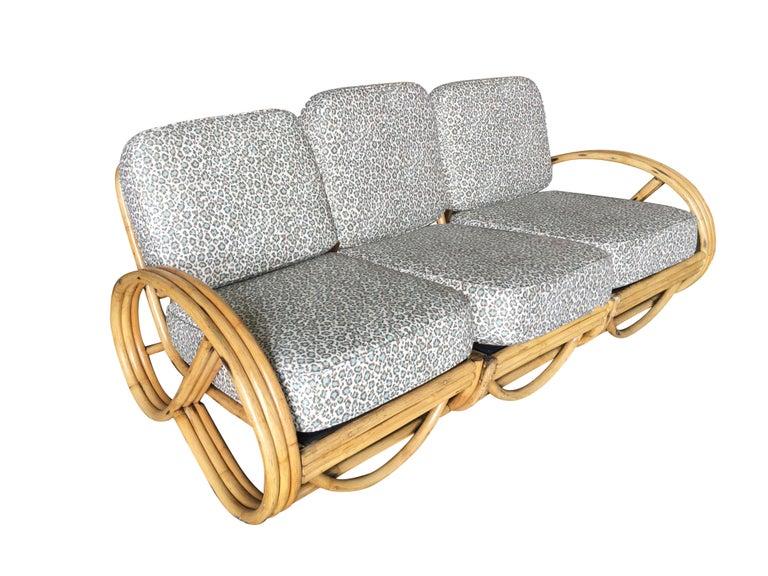 This round 3/4 three-strand round pretzel arm rattan three-seat sofa sectional.  Sofa measures: 29