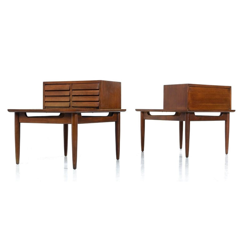 Pair of professionally refinished Dania lamp tables by American of Martinsville. One of the most celebrated lines of the Mid-Century Modern era. Designed by Merton Gershun, this set of Dania nightstands features Danish inspired minimalist styling