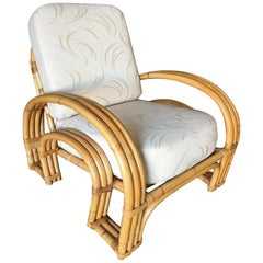 "Restored ""Double Horseshoe"" Rattan Three-Strand Lounge Chair"