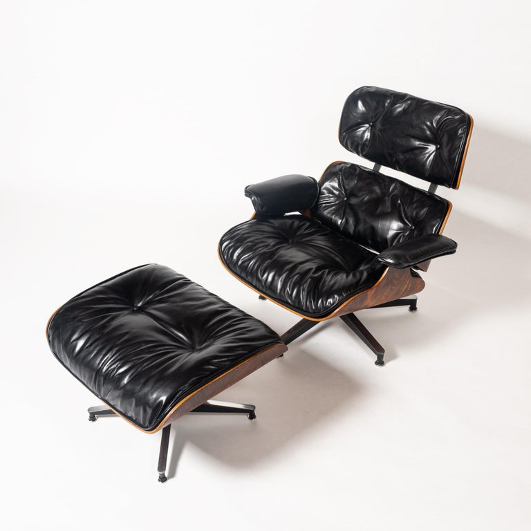 This extremely rare collectible is one of the earliest known productions of the 1956 Eames lounge chair with ottoman, non-stamped frame. In classic black and rosewood lacquered shell, this piece has been professionally restored by Modern Conscience