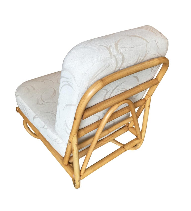 Designed in the style of designer Paul Frankl, this 1940s floating rattan lounge features two swoop arch legs that give the chair a floating appearance.   Custom cushions C.O.M. (Customers Own Material) are included in the price. Simply supply the