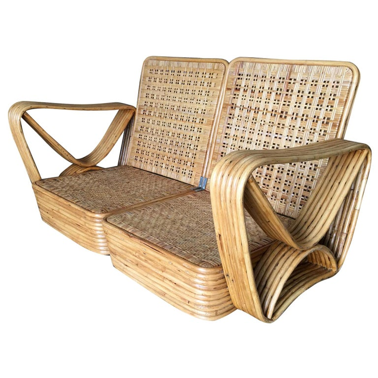 Paul Frankl style stick rattan living room set including a matching three-seat sectional sofa, Ottoman and pair of end tables. The sofa features the famous six strand square pretzel side arms and stacked rattan base with matching stacked rattan side