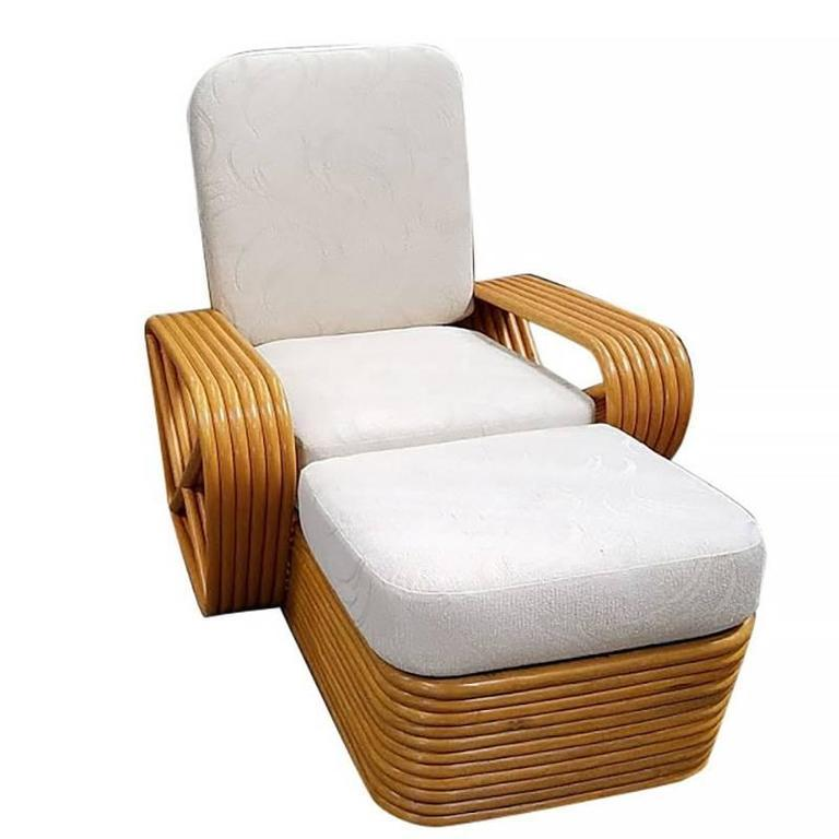 Designed in the manner of Paul Frankl, this six-strand, rattan chaise lounge chair features square pretzel arms and a classic rattan stacked base.  Available three  Custom cushions C.O.M. (Costumers Own Material) are included in the price. Simply
