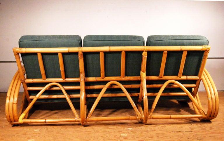 Mid-Century Modern Restored Paul Frankl Style Round Pretzel Arm Rattan Sofa For Sale