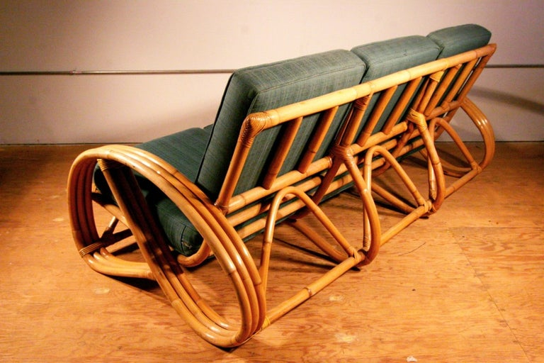American Restored Paul Frankl Style Round Pretzel Arm Rattan Sofa For Sale