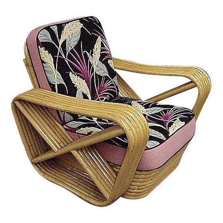 Designed in the manner of Paul Frankl, this six-strand, rattan lounge chair features square pretzel arms and a Classic stacked base.  If you supply your own fabric we'll have the cushions fabricated for you at no extra charge, otherwise, we'll