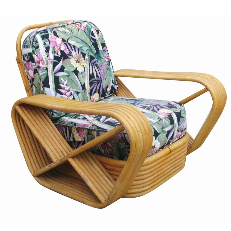 Designed in the manner of Paul Frankl, this six-strand, rattan lounge chair features square pretzel arms and a Classic stacked base. Included is the matching stacked rattan ottoman.   Custom cushions C.O.M. (Costumers Own Material) are included