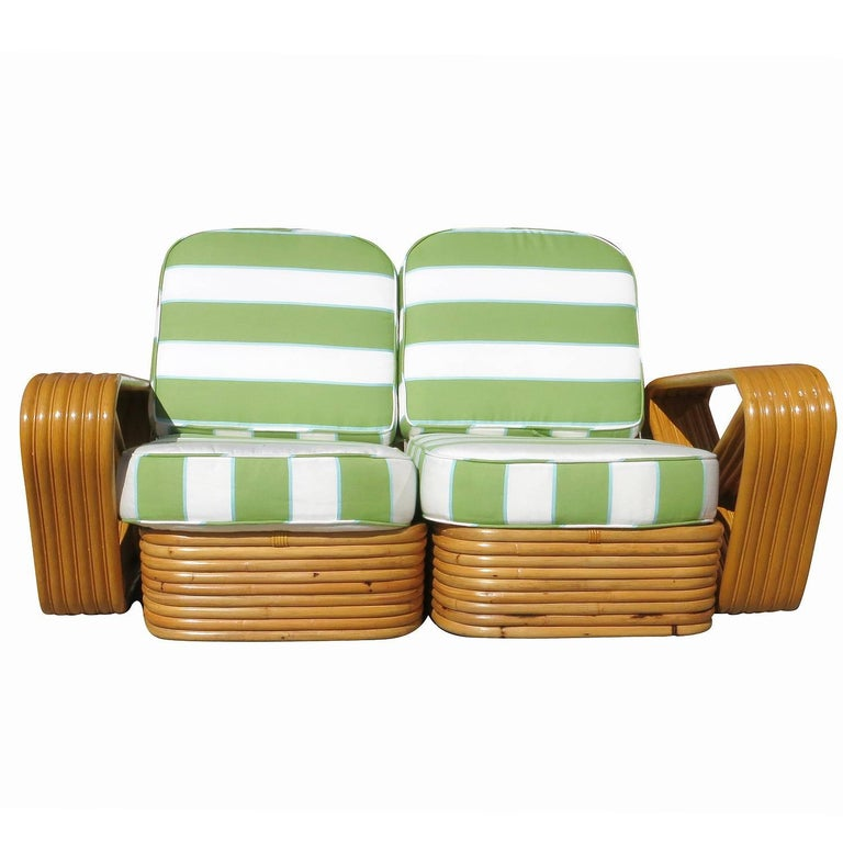 Paul Frankl style six-strand square pretzel rattan settee with custom made cushions available C.O.M. 