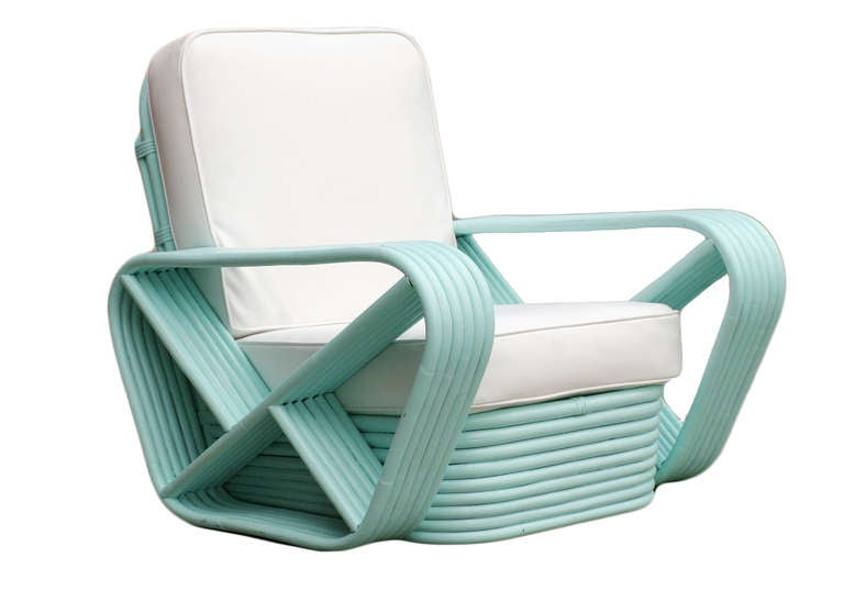 Six strand square pretzel arm rattan occasional chairs with stacked base in the style of Paul Frankl. Both chairs have been professionally custom painted in a teal finish. 