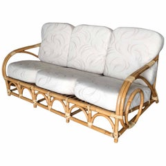 "Restored Two-Strand ""Circles and Speed"" Three Seat Rattan Sofa"