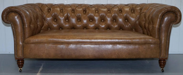 We are delighted to offer for sale this lovely fully restored aged brown heritage leather Victorian Chesterfield club sofa with a walnut frame   This sofa has been fully restored to include new leather upholstery, the legs have been lightly