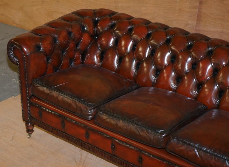 Victorian Restored Vintage Oxblood Bordeaux Leather Chesterfield Club Sofa on Turned Legs For Sale