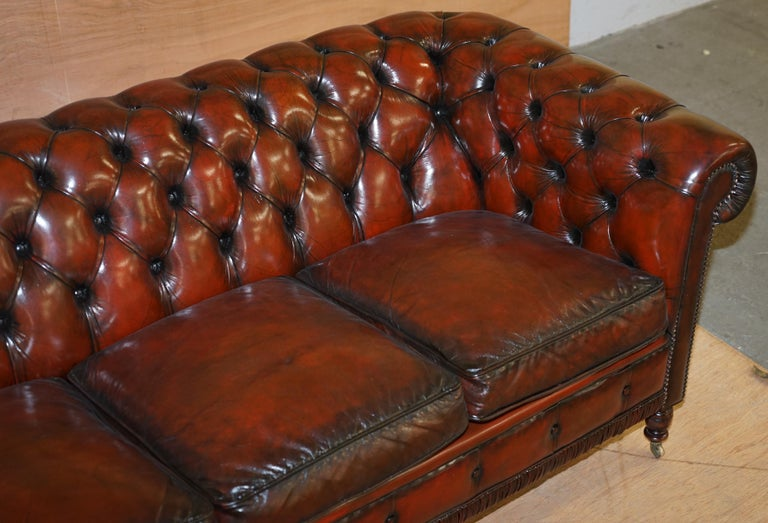 English Restored Vintage Oxblood Bordeaux Leather Chesterfield Club Sofa on Turned Legs For Sale
