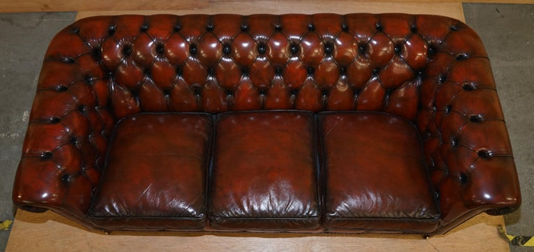 Hand-Crafted Restored Vintage Oxblood Bordeaux Leather Chesterfield Club Sofa on Turned Legs For Sale