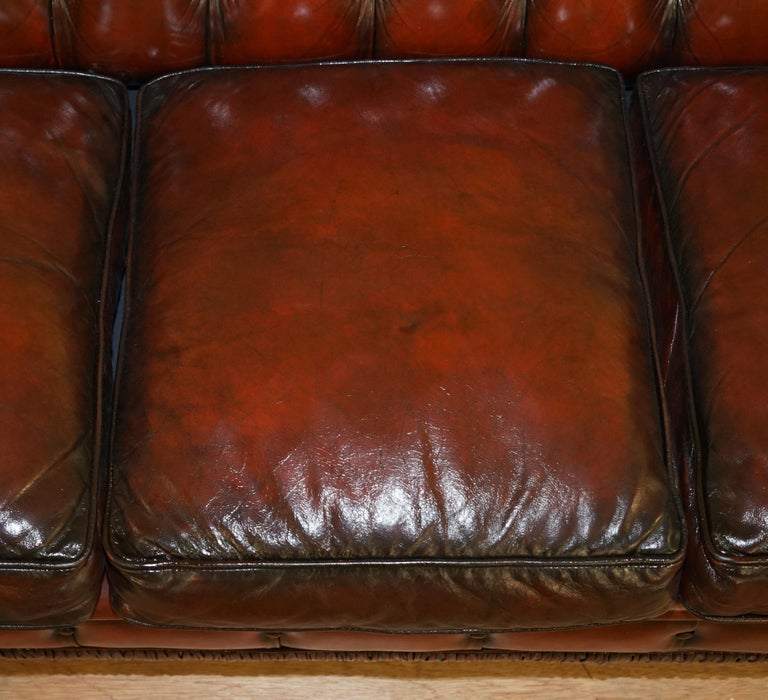 20th Century Restored Vintage Oxblood Bordeaux Leather Chesterfield Club Sofa on Turned Legs For Sale