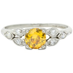 Retro 0.60 Carat Orange-Yellow and White Diamond Platinum Engagement Ring GIA