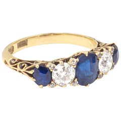 Retro 1.10 Carat Sapphires Diamonds 18 Carat Yellow Gold Jarretière Ring