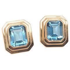 Retro 12 Carat Gold Natural Emerald Cut Blue Topaz Gem Stone Earrings circa 1970