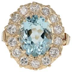 Retro 14 Karat Gold 4 Carat Aquamarine and 1.3 Carat Diamond Halo Enamel Ring