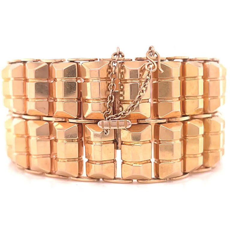 Retro 18 Karat Rose Gold Tank Bracelet. Circa 1940's. 7 1/4 inches.   About The Piece: Do you like a bold gold look? You're in luck because substantial gold pieces are the hottest trend of the new decade. This bracelet is solid, confident and