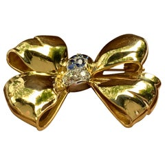 Retro 18 Karat Yellow Gold Bow Brooch with Sapphires and Diamonds