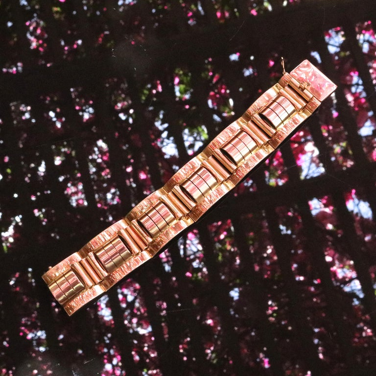 Everything you love about film noir, black and white photographs are represented by this bold retro bracelet. 18k yellow & rose gold. Weighs 115 grams. Our 1stdibs Recognized Dealer/Platinum Seller Guarantees:  7 day return policy for full cash