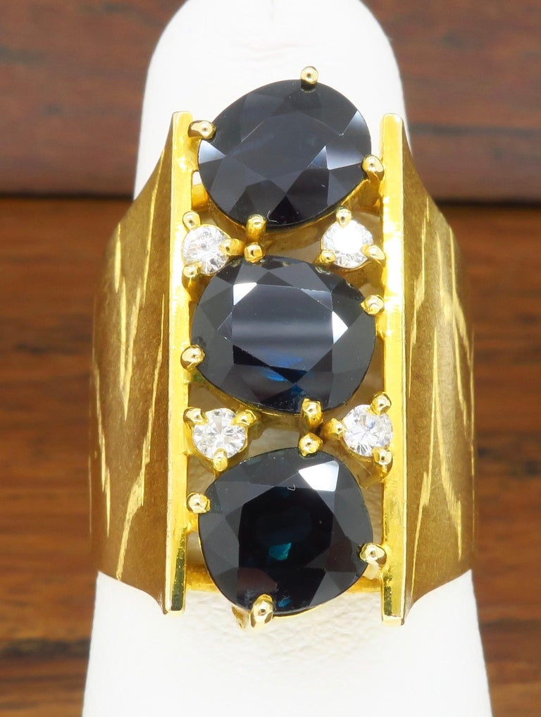 Retro Oval Blue Sapphire & Diamond ring made in 18k yellow gold.   Gemstone: Blue Sapphire & Diamonds Diamond Carat Weight: .12CTW Metal: 18k Yellow Gold  Marked/Tested: Tested 18k  Weight: 11.7 Grams Ring Size: 5.5 - 6