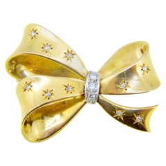 Retro 1940s Diamond Bow Ribbon Yellow Gold and Platinum Brooch