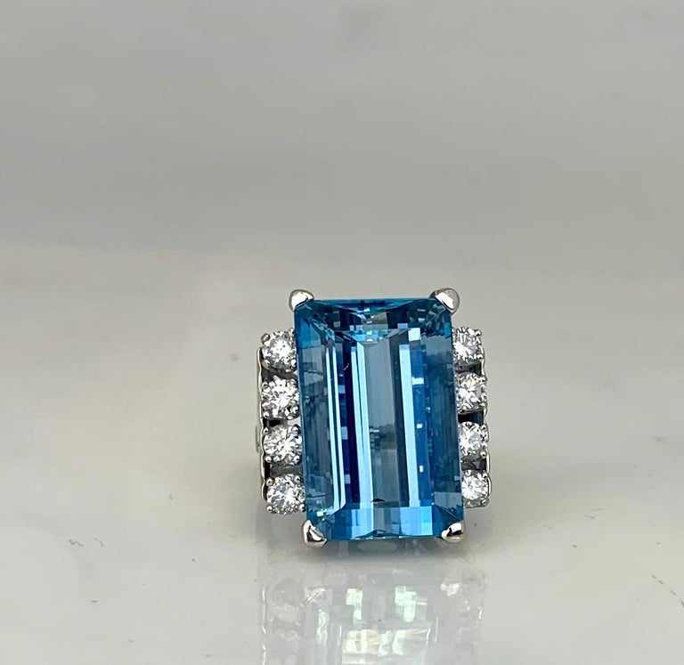 This aquamarine and diamond ring has a perfect balance of the cool slate blue Aquamarine and white diamonds that shows why this ring is superior to many others.  The center stone measures 20 x 12.73 x10.84mm and carries an idealistic Aquamarine Blue