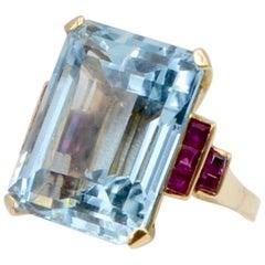 Retro 31 Carat Aquamarine and Ruby Ring in 14 Karat Yellow Gold