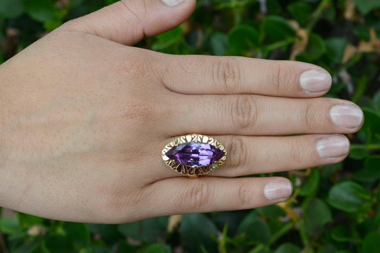 Vintage 1940s Retro era estate jewelry statement pieces are so hot right now. You will love to rock this huge, 8.34 carat marquis amethyst stunner. With awesome finger coverage and a rich, royal purple gemstone holding court, you will love the