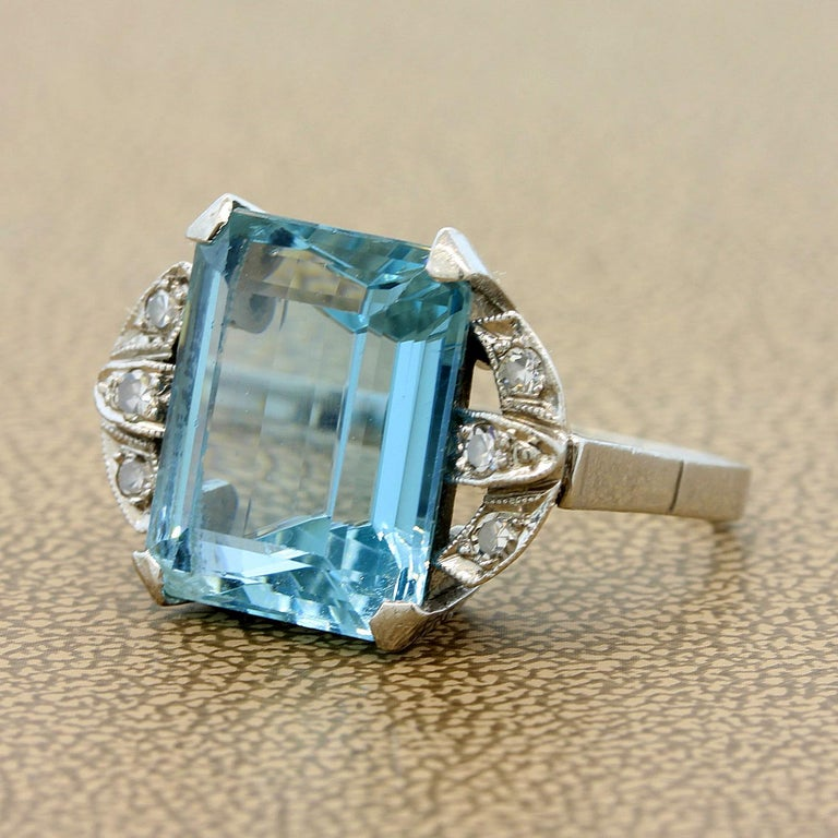 A classic Retro piece from the 1930's made in platinum featuring a 8.15 carat luscious blue aquamarine.  There are 6 diamond accents on each side of the aquamarine, set in platinum.  Size 5
