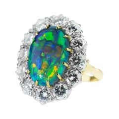 Retro Australian Black Opal and Diamond Cluster Ring in 18 Karat Gold