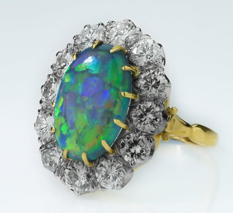 Oval Cut Retro Australian Black Opal and Diamond Cluster Ring in 18 Karat Gold For Sale