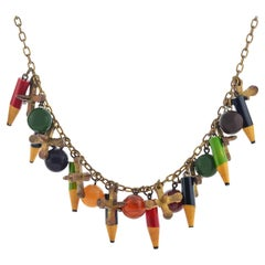 Retro Bakelite Pencil, Jacks, and Marbles Charm Necklace