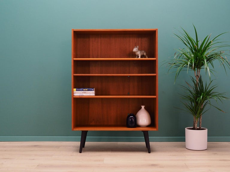 Classic bookcase, library from the 1960s-1970s. Scandinavian design, Minimalist form. The surface of the furniture finished with teak veneer. Shelves with height adjustment. Preserved in good condition (small bruises and scratches, filled veneer