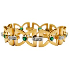 Art Deco Bow-Tie Link Bracelet in 18 Karat Yellow Gold with Emerald and Diamonds