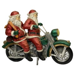 Retro Christmas Sculpture of Two Santa Clauses on Motorcycle