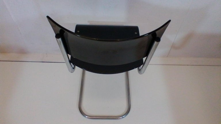 Manufakturer is n.p. Kovová - Lysá nad Labem, závod Bystrice pod Hostynem. Funktionalism. The item made is from chrome and plywood. Chrome is in original condition. Wooden surfaces the chair are painted with polyurethane quality varnish in high