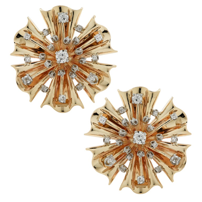 Stunning retro brooch pin/pendant and earring set crafted in yellow gold, featuring 80 old mine cut and Old European cut diamonds weighing approximately 2 carats total, J-K color, SI clarity. The gold is fluted and molded into flowers adorned with