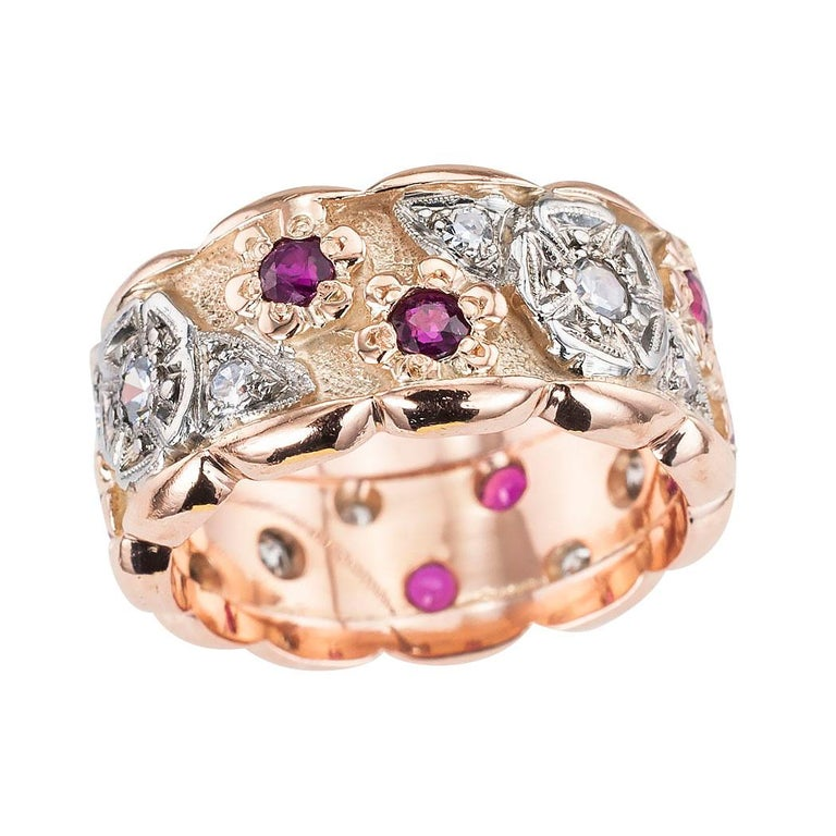 Retro diamond and ruby pink gold 10 mm wide eternity ring circa 1940, ring size 7 ¾. Love it because it caught your eye and we are here to connect you with beautiful and affordable jewelry.  Make yourself happy!  Simple and concise information you
