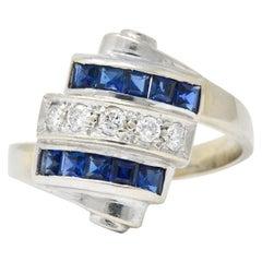 Retro 0.80 Carat Diamond Sapphire 14 Karat White Gold Scrolled Bypass Ring