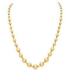 Retro French 18 Karat Yellow Gold Graduated Ball Chain, circa 1940s