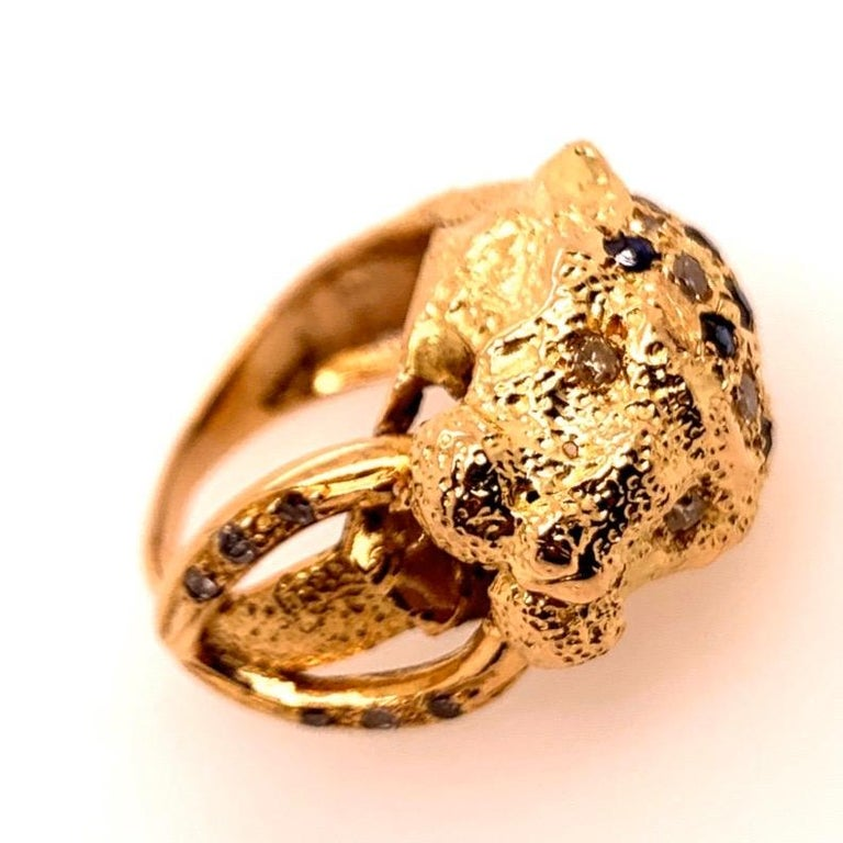 Retro Yellow Gold Lion Ring set with 19 Natural Diamonds (G-J color, SI-I clarity) and 11 Sapphires, weight of stones are approximately 0.60 carats.  Circa 1960.   The ring is a size 4.5 and total weight is 9 grams.