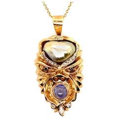 Retro Gold Warrior Head Natural Pearl, .30 Carat Diamond & Sapphire Pendant 1950